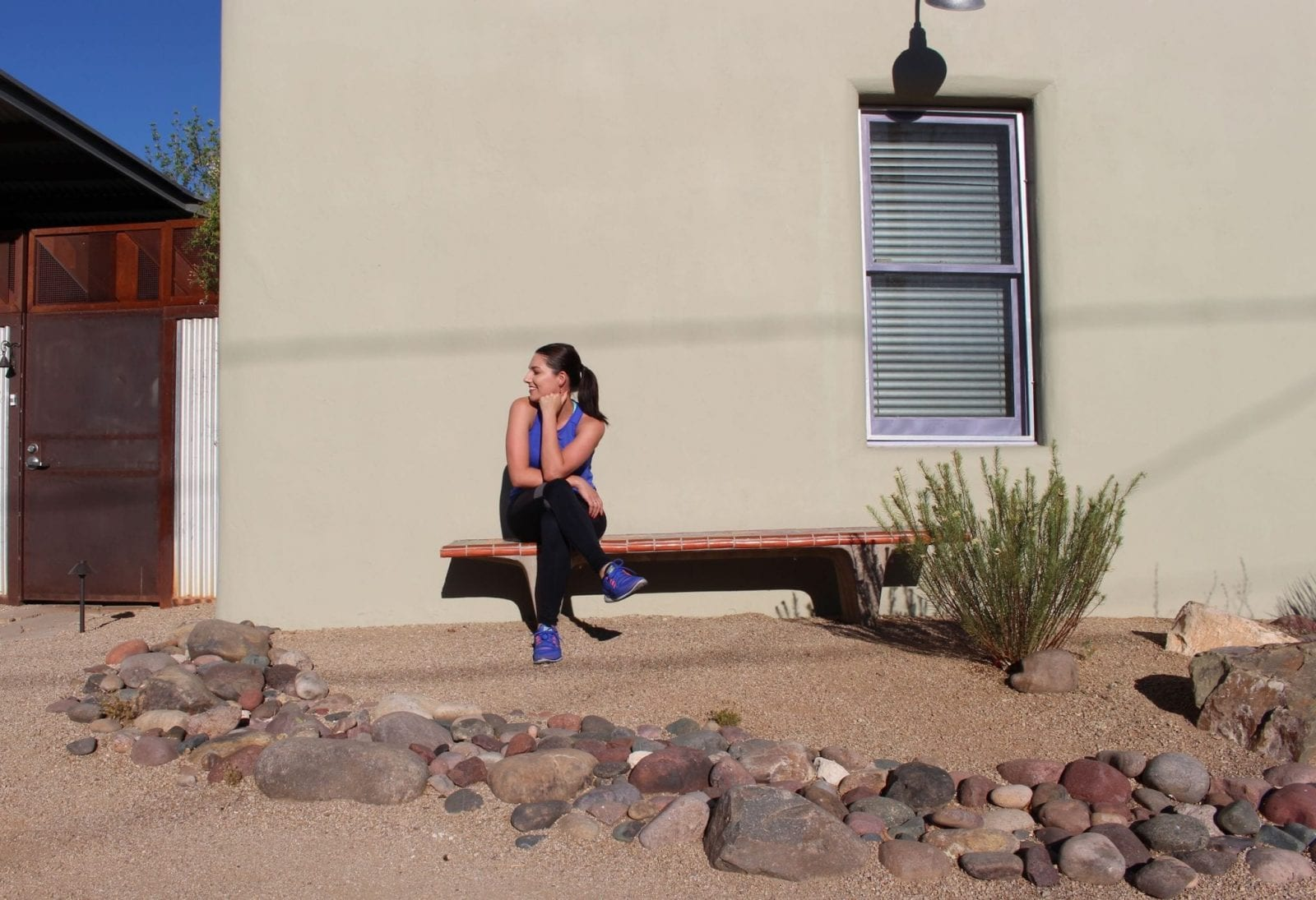 This is a photo of me sitting on a bench in my Sweaty Betty workout attire.
