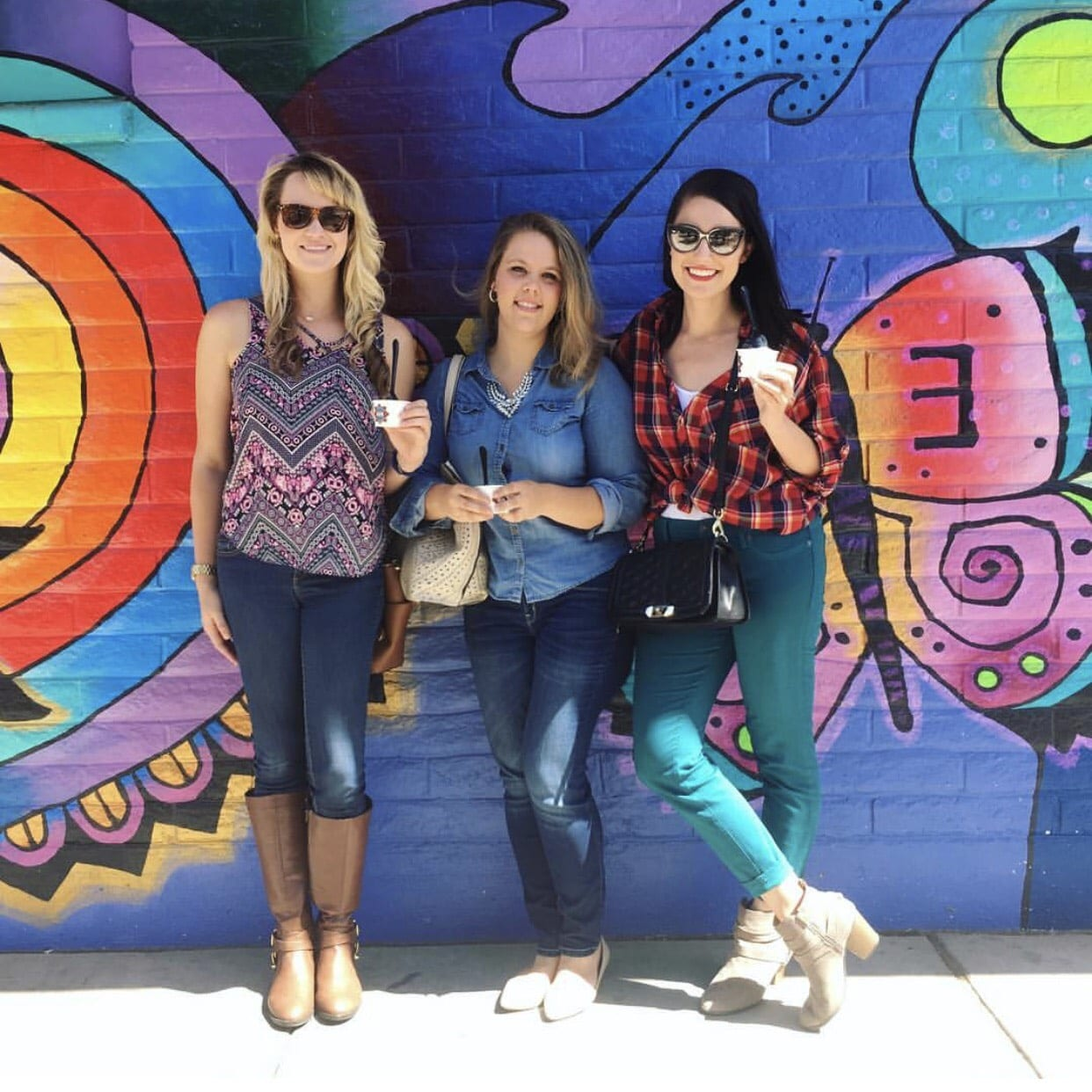 This is a group photo of my friends & I against an art mural in downtown Tucson.