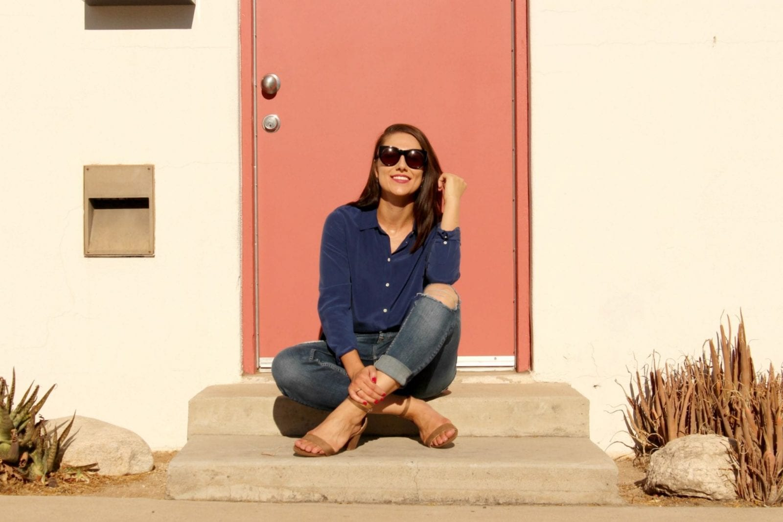 This is a shot of me rocking an Everlane blouse wiht blue jeans and ZooShoo sandals.