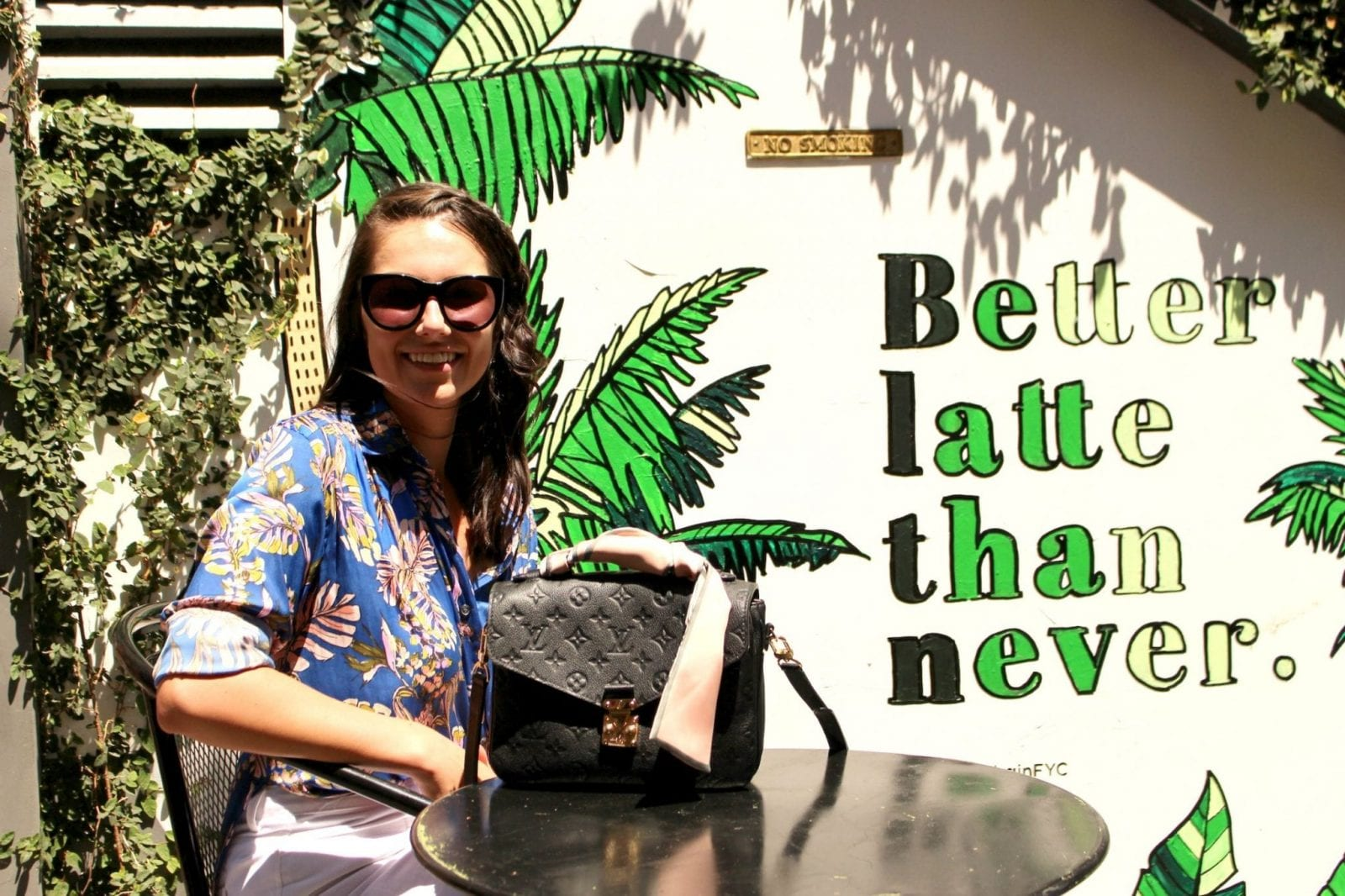 This is a photo of me sitting at a coffee table with my hawaiian shirt and my Louis Vuitton bag in Los Angeles.