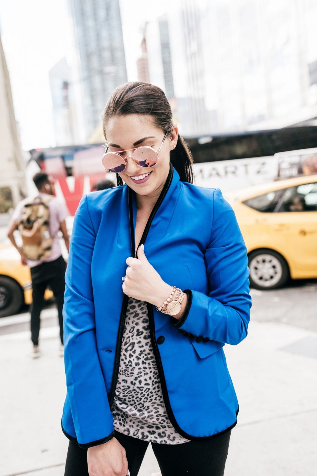 This is a photo of me in a Heidi Klum Esmara Blue Jacket, and black jeans in New York City.