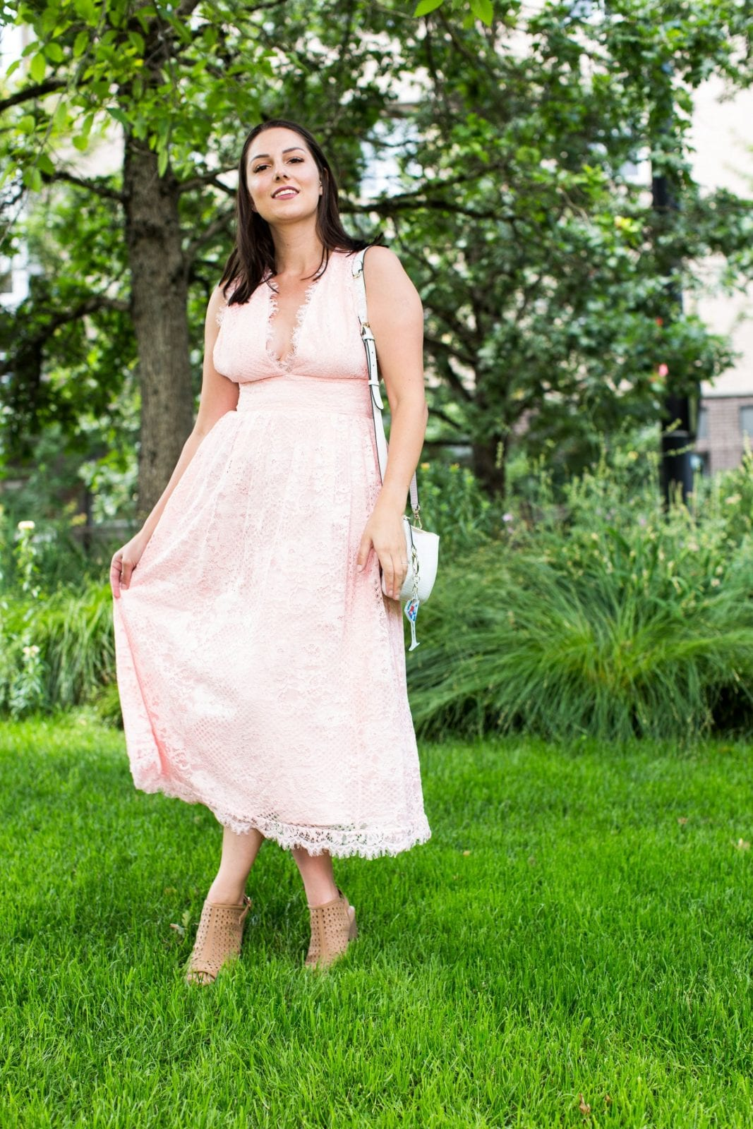 This is a full body shot of me in a pink lacey dress from Revolve, while in Portland Oregon.
