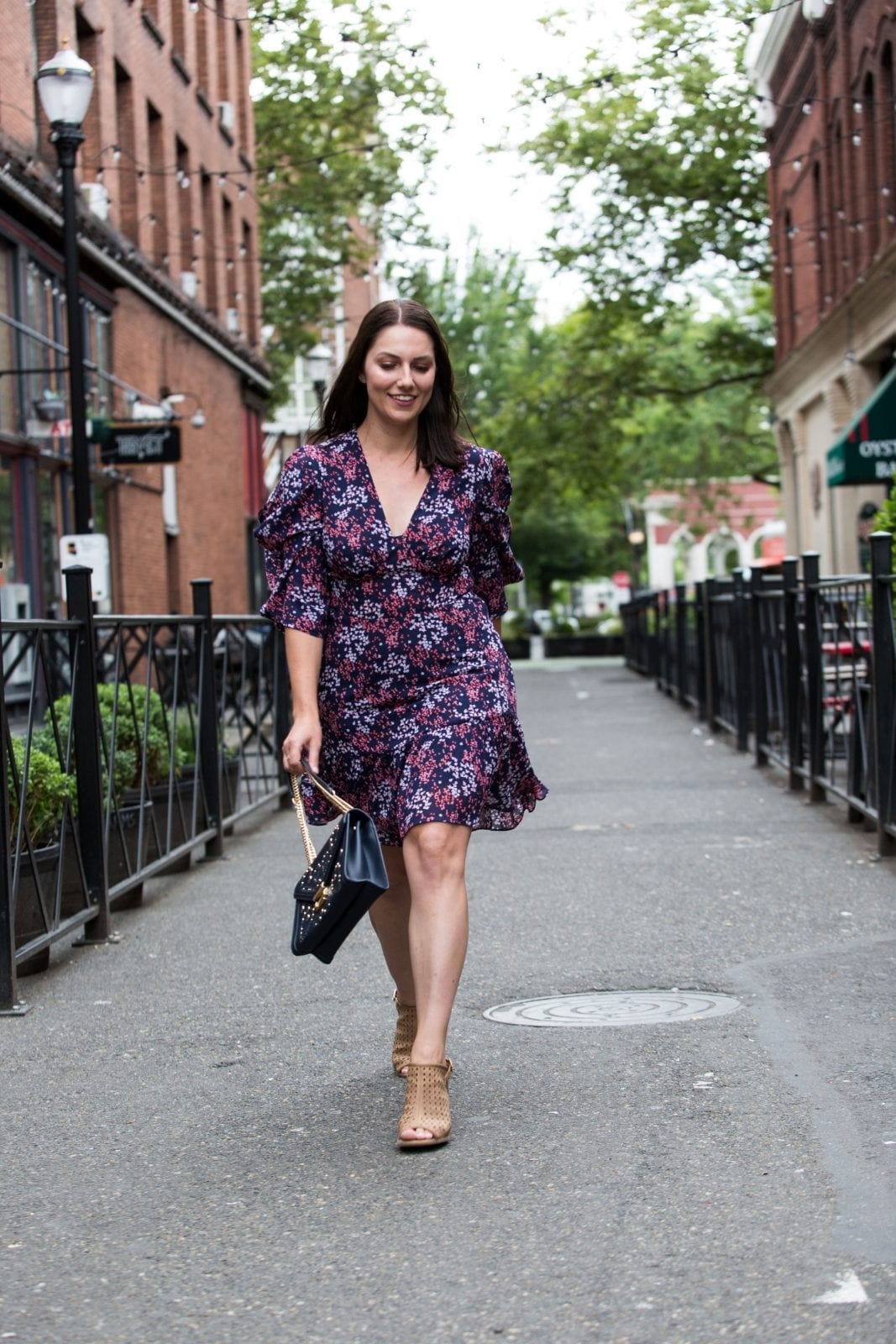This is a full body shot of me walking down the street in a Michael Kors dress with some wedges from Francesca's.