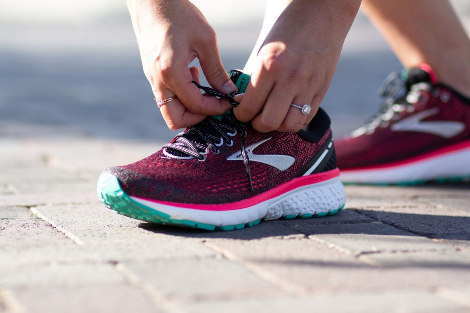 This is a close up ground shot of the new Brooks Ghost 11 running shoes, in the pink and teal color option.