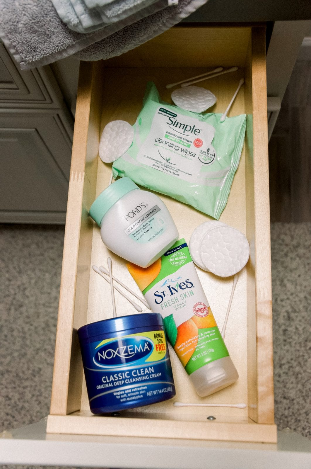 This is a close up of my bathroom drawer featuring Ponds, Noxzema, St. Ives and Simple.
