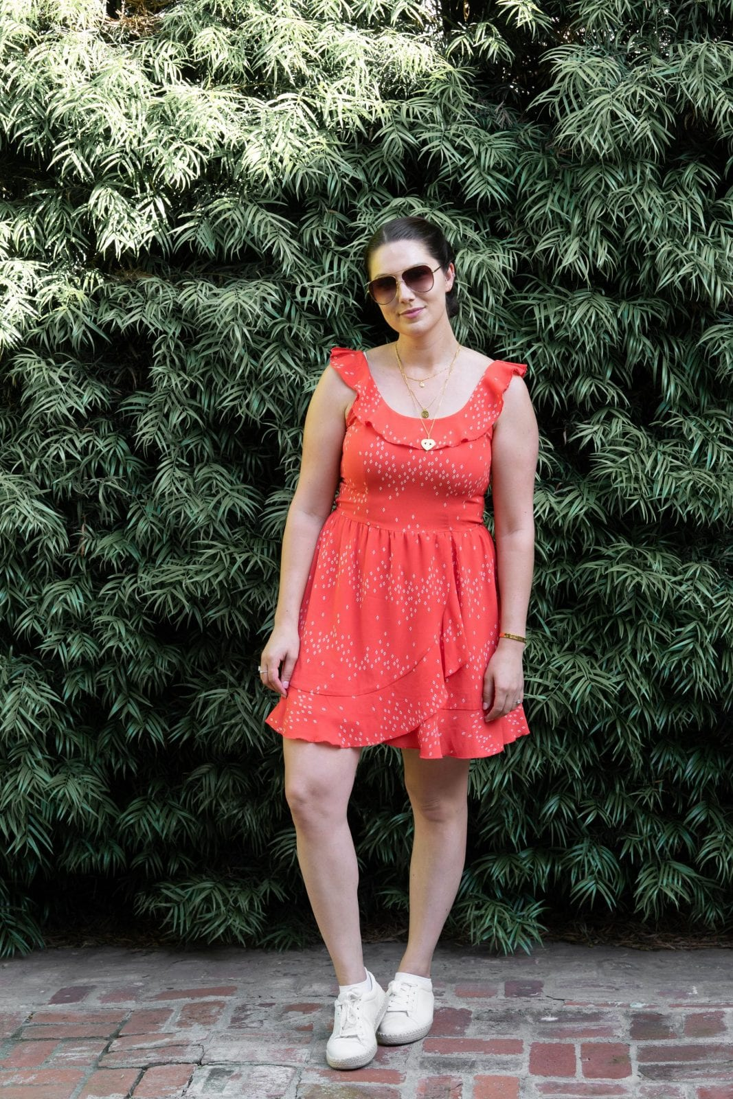 This is a full body shot of me standing behind a hair salon in Santa Monica California in a red orangeish Speechless dress.