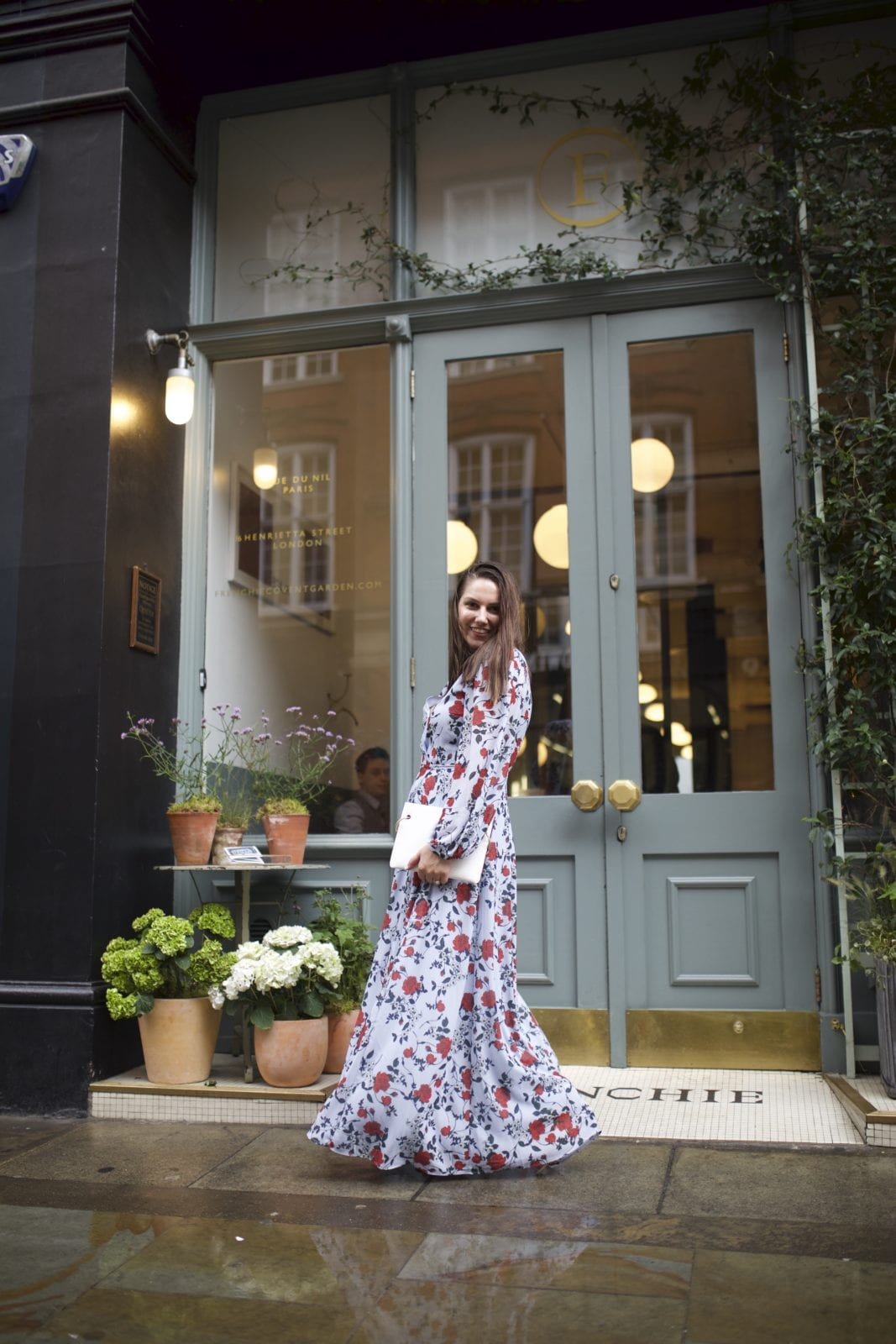 In this photo, Adaleta Avdic is twirling around in a beautiful maxi floral dress from the new Yumi Kim collection, in the city of London close to Covent Garden.