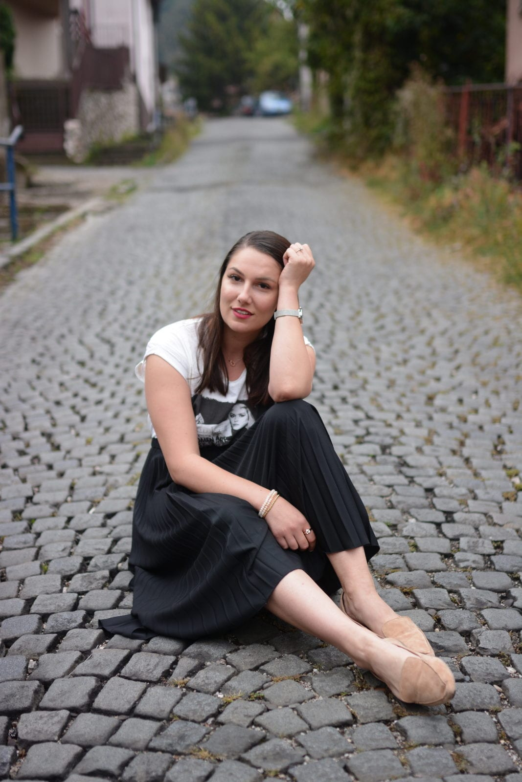 This is a photo of me sitting in the middle of a cobblestone street in Tuzla, Bosnia and Hercegovina.