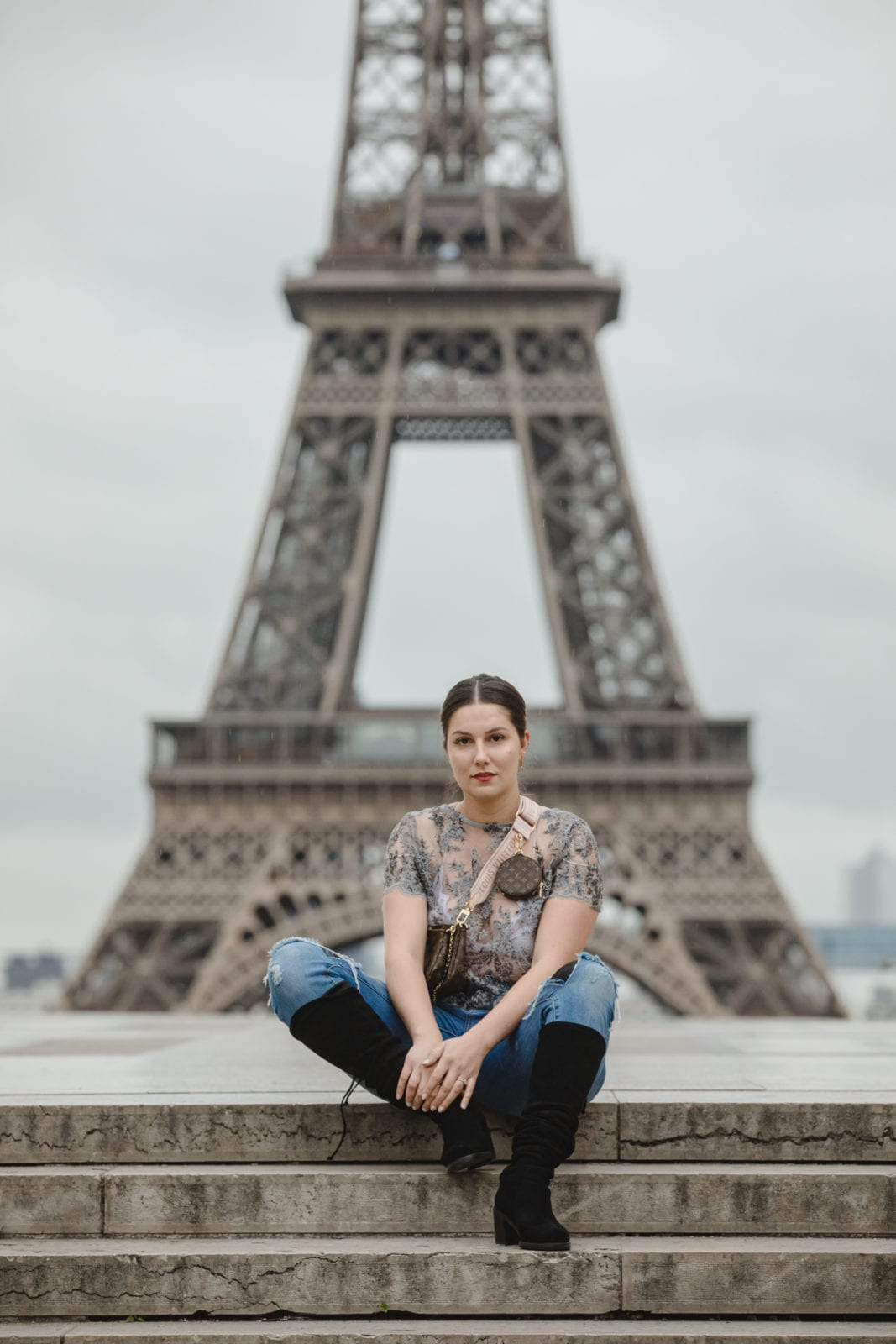Sitting on the steps by Trocadéro in front of the Eiffel Tower.