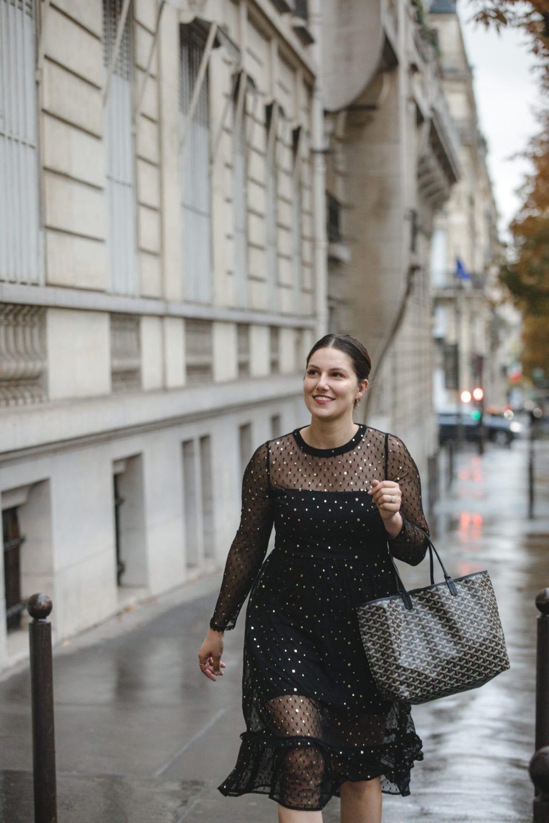 Walking down the street rocking a black Avec les Filles dress, through Paris.