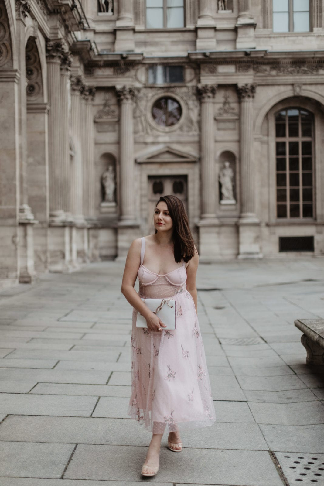 This is a photo of Adaleta Avdic rocking a pink Revolve dress in Paris France.