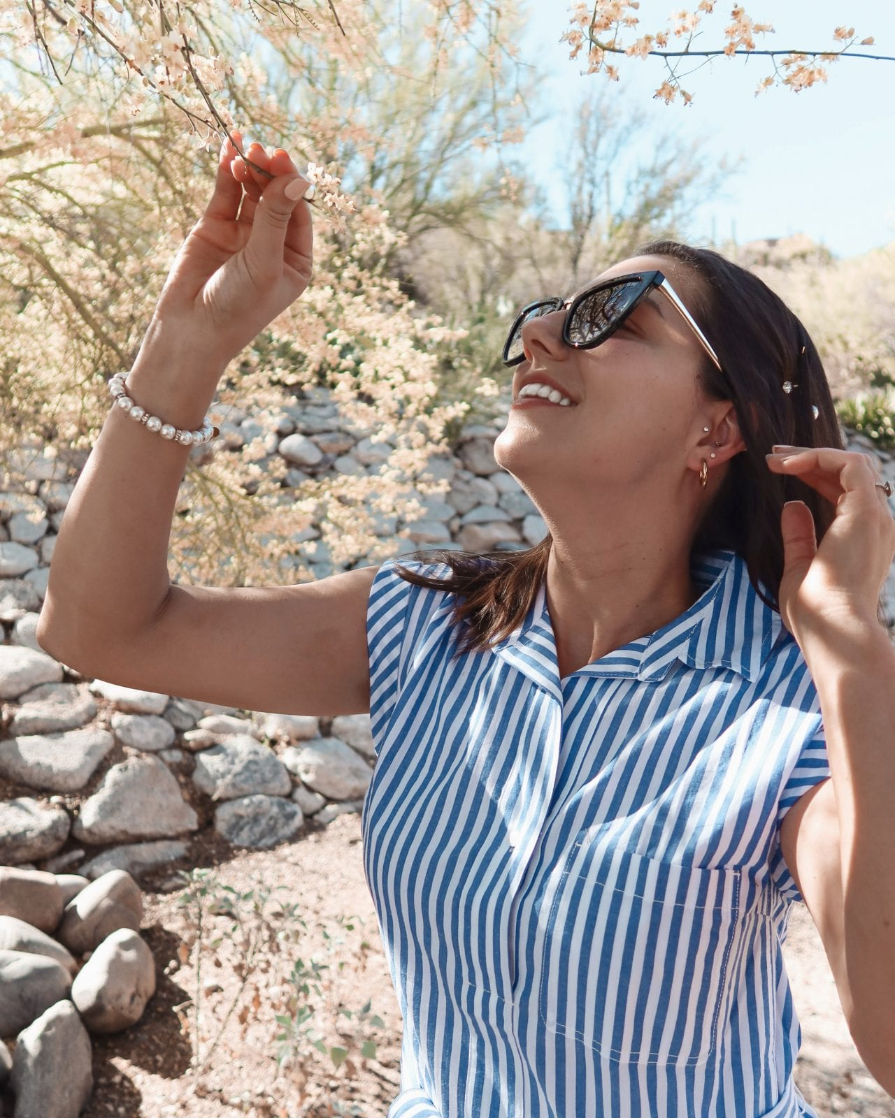 This is a close up shot of Adaleta Avdic wearing a cute Mott and Bow dress, with Quay sunglasses in Tucson Arizona.