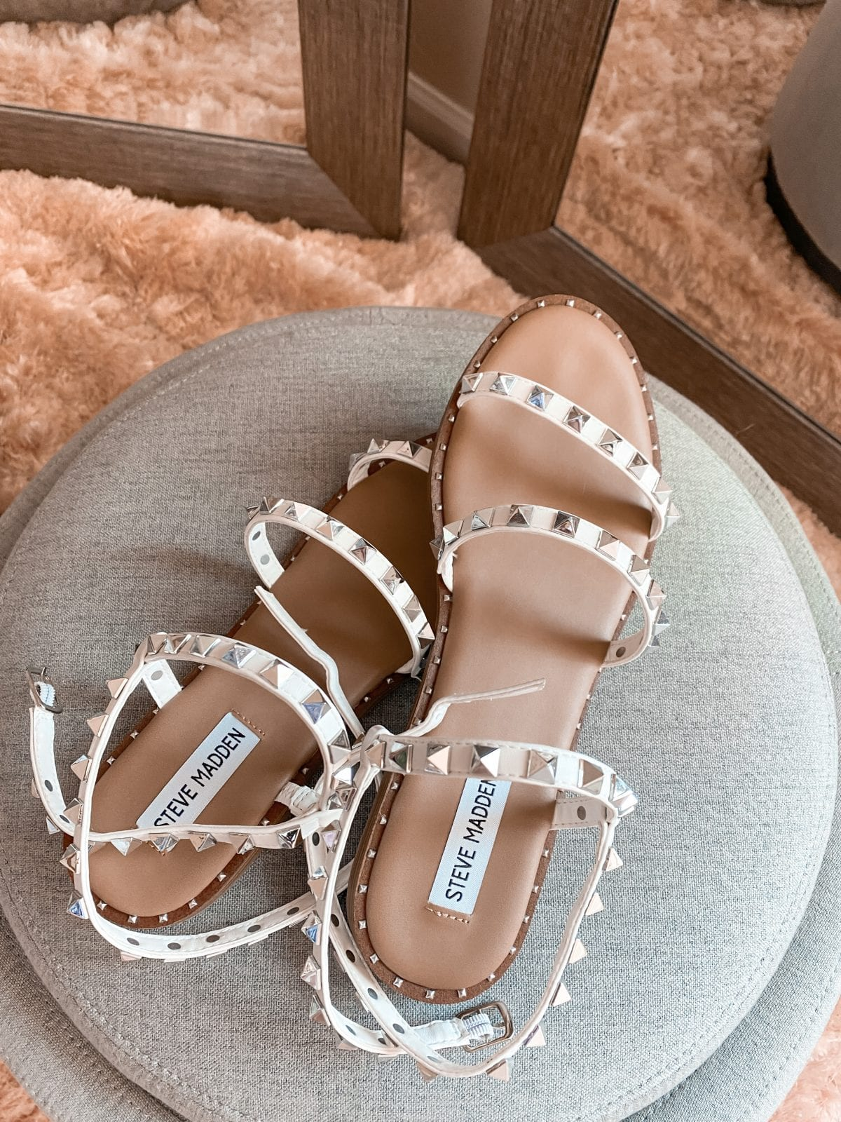 This is a close up of some studded sandals from Steve Madden, worn by Adaleta Avdic.